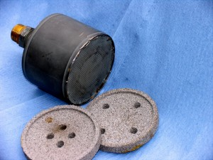 Absorption muffler with hollow metal sphere structure